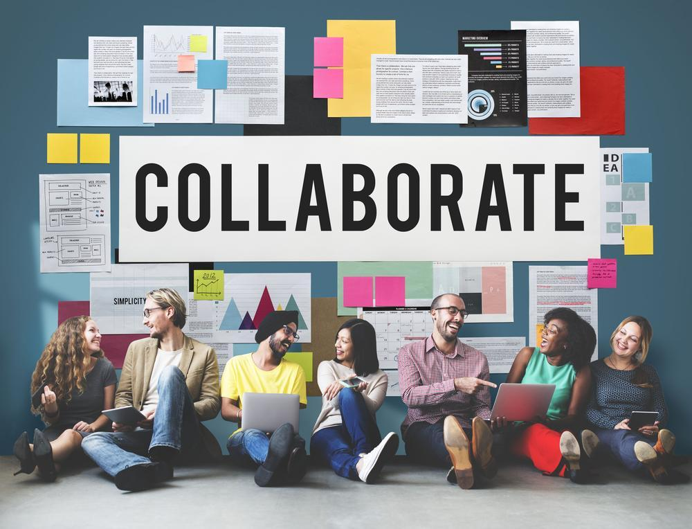 workplace collaboration - people by a noticeboard